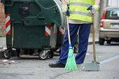stock photo of broom  - Process of urban street cleaning sweeping - JPG