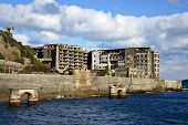 Abandoned island of Gunkanjima off the coast of Nagsaki, Japan. The island was populated as a coal m