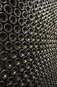 Full frame shot of bottles in wine cellar