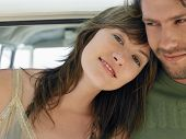 picture of campervan  - Portrait of beautiful young woman relaxing on boyfriend - JPG