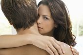 stock photo of intimate  - Portrait of romantic young woman kissing on man - JPG
