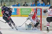 INNSBRUCK, AUSTRIA - JANUARY 21 Shane Gersich (USA) tries to score a goal a his team loses 7:5 toin