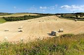 Cornwall country scene with hay bales like cotton reels on a beautiful summer day