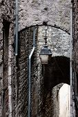 picture of downspouts  - Downspouts and antique lantern in Sisteron - JPG