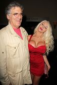LOS ANGELES - JUL 12:  Elliott Gould, Courtney Stodden at the Dave Stewart: Jumpin' Jack Flash & The Suicide Blonde Photo Exhibit at the Morrison Hotel Gallery on July 12, 2013 in West Hollywood, CA