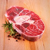 stock photo of veal meat  - Fresh veal shank meat with herb on wood background top view - JPG