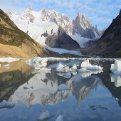 Cerro Torre mountain and lake at sunrise.