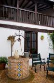 Well Detail An Botijo In Typical Patio From Castilla La Mancha House. Posada In Toledo, Spain