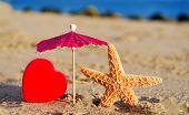 Starfish With Heart On The Sandy Beach
