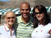Katie Lohmann with Amaury Nolasco and Karen McDougal at the 7th Annual Playboy Golf Scramble Champio