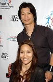Dustin Nguyen and wife Angela at a Fashion and Music Extravaganza Promoting Human Rights for Youth.