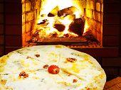 Pizza Quatro Formaggi And Open Fire In Oven