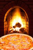 Pizza With Ham And Open Fire In Oven