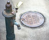 image of spigot  - An outdoor water spigot and water meter - JPG