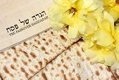 image of piety  - spring holiday of Passover and its attributes, with matzo and Haggadah in Hebrew - Happy Passover