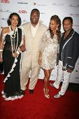 Rodney Peete with Holly Robinson Peete and guests at the DESIGNCARE 2007 Fundraiser to benefit those battling debilitating disease and life circumstances. Private Residence, Malibu, CA. 07-21-07