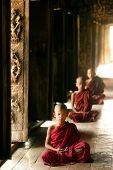 Three Young Monks Sitting At Shwenandaw Monastery In Mandalay,Myanmar .