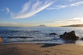 foto of gibraltar  - A sunset beach with Gibraltar in the distance - JPG