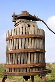 stock photo of wine-press  - old italian wooden wine press for pressing grapes yo produce wine - JPG