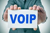 foto of voip  - man wearing a suit holding a signboard with the text VOIP - JPG