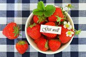 Get well card with bowl of fresh strawberries on checkered cloth