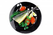 image of smoked mackerel on black plate with caviar