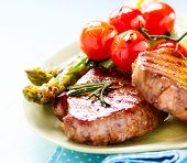 Grilled Beef Steak Meat with Asparagus and Cherry Tomato. Steak Dinner. Food. BBQ Grill. Berbeque. Barbecue