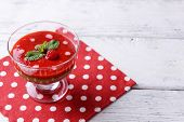 Strawberry, kiwi fruit and raspberry smoothies in glass bowl on color wooden background