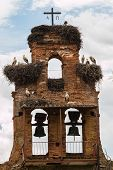 Old Bell Gable Invaded By Stork Nestes In A Village Of Spain