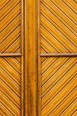 Wooden Rhomboid Pattern In A Yelowish  Door
