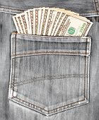 A Hundred Dollar Bills Sticking In The Back Pocket Of Denim Black Jeans