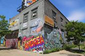 Building covered with murals and graffiti in Williamsburg section in Brooklyn