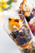 Blackberry parfait with ice cream,caramel sauce and pecan