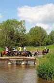 Horse riding in river, Lower Slaughter.