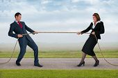 Businessman And Woman Tug Of War