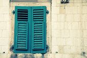 Window With Green Shutters In Old House