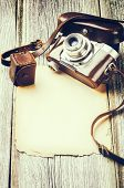 Retro Camera On Old Wood Background