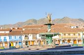 CUZCO, PERU, MAY 1, 2014 - Plaza de Armas, with the statue of the Inca shining on top of the fountain.
