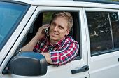 Young Blond Man In Car On Cell Phone