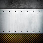 metal with caution stripe