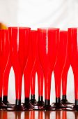 Red Plastic Glasses On Gray Background