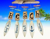 stock photo of chimes  - Beach Wind Chime on Beach background - JPG