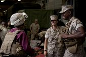 NEW YORK - MAY 22, 2014: Military personnel speaks to visitors during a public tour on the well deck