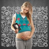 Pregnant woman looking for Christmas gifts and choosing it