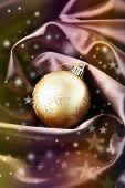 Beautiful Christmas ball on satin cloth