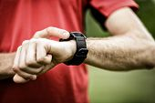 Постер, плакат: Runner Looking At Sport Watch