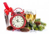 Champagne, christmas clock and fir tree. Isolated on white background