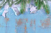 Christmas composition with fir tree with toys and snow on wooden background