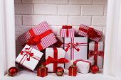 Christmas gifts in fireplace, close-up