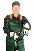 picture of trimmers  - Experienced gardener with trimmer and ear protectors - JPG
